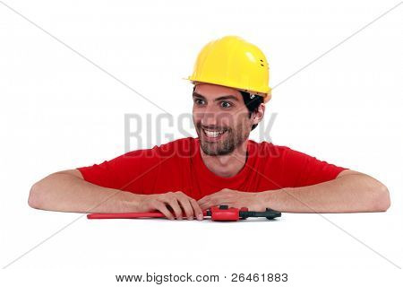 Manic looking manual worker