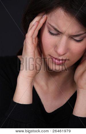 Woman suffering from a throbbing headache