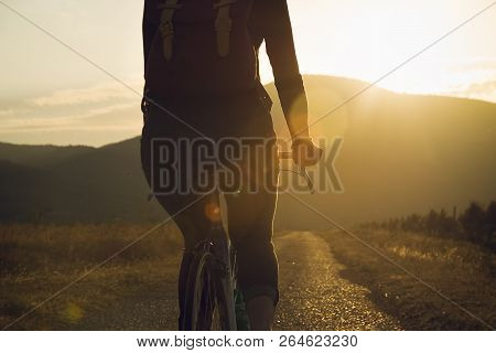 Hipster Woman Cycling In Sunset In Countryside. Healthy Lifestyle. People Lifestyle. Hipster People