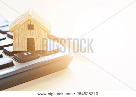 Business, Finance, Savings, Money Management, Property Loan Or Mortgage Concept :  Wood House Model