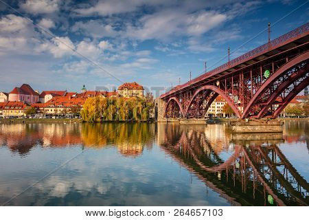 Maribor, Slovenia. Cityscape Image Of Maribor, Slovenia During Autumn Day With Reflection Of The Cit