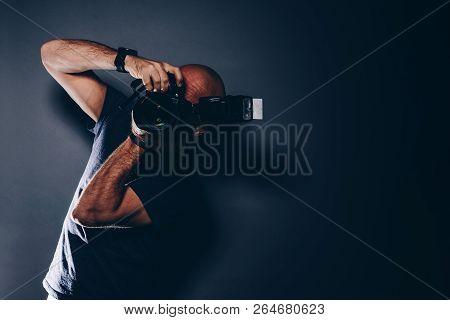 Male Photographer Portrait In Studio