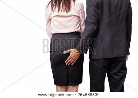 Sexual Assault And Abuse Against Women At Work Concept. Male Manager Molesting Female Employee By To
