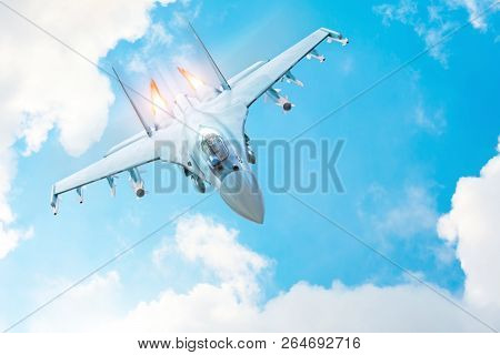 Combat Fighter Jet On A Military Mission With Weapons - Rockets, Bombs, Weapons On Wings, With Fire