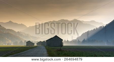 View Of The Praettigau Valley Near Klosters In Switzerland On An Early Morning With Farm Fields And