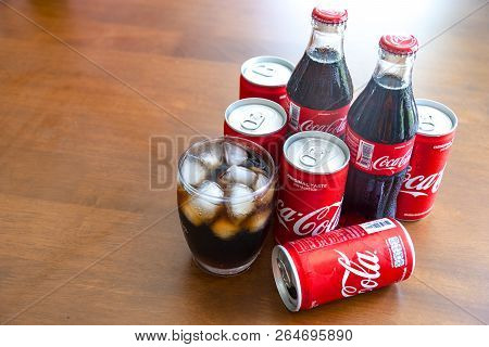 Bangkok, Thailand - October 23, 2018: Coca-cola With Ice In Glass And Can,bottle Of Coca-cola On Woo