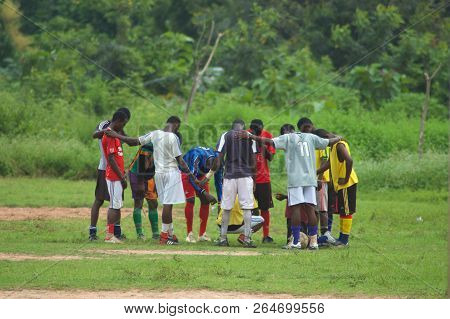 Donkorkrom, Ghana: July 20th 2016 - Young Men In A Circle Praying Before A Football Gain In Ghana, W