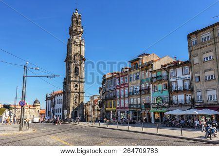Porto 30 September, 2018: On The Streets Of Porto, Passersby Near Torre Dos Clerigos.
