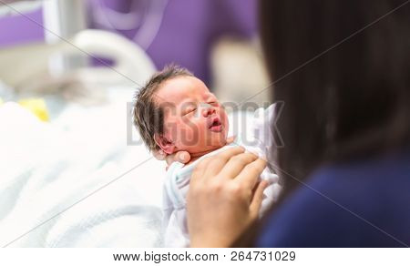 Newborn Baby Boy Being Cared For In The Hospital By His Mother