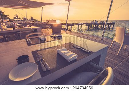 Outdoor Restaurant At The Beach. Table Setting At Tropical Beach Restaurant. Table Setting At Tropic