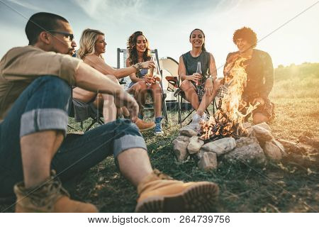 Friends Hanging Out By The Campfire