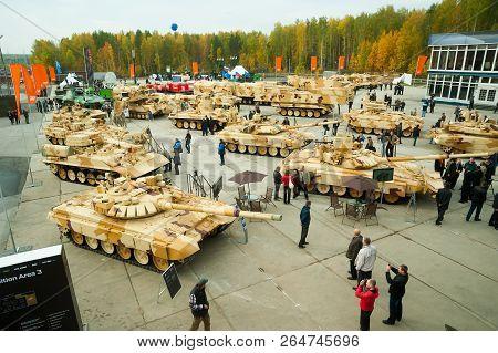 Nizhniy Tagil, Russia - September 25. 2013: Visitors Explore Military Equipment On Exhibition Range.