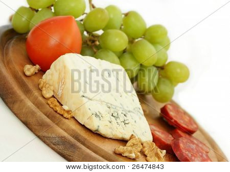 Grape, cheese with nuts and sausage