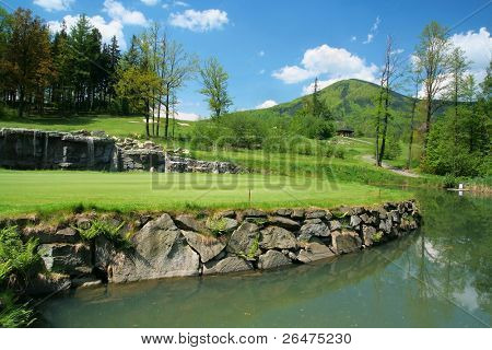 Golfcourse and beauty surroundings with water-jump