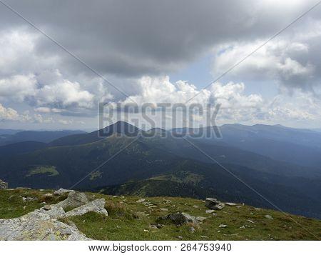Landscape Of Hillsides And Mountain Pasture. Carpathians Mountains At Summer, West Ukraine. Sky Cove