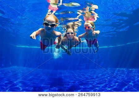 Happy Family - Mother, Baby Son, Daughter In Goggles Swim, Dive In Pool With Fun - Jump Deep Down Un