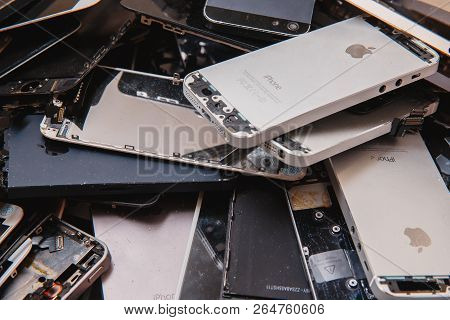 Tomsk, Russia - November 29, 2017: Broken Panels And Screens Of Iphone Phones Lie In The Service And