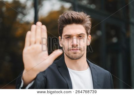 Portrait Of Young Businessman Disapproval Gesture With Hand: Denial Sign, No Sign, Negative Gesture