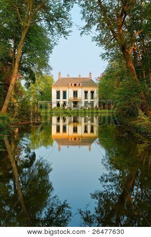Small castle and beauty reflection in water