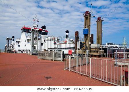 White ferry loading in port