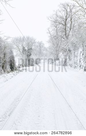 British Country Road In Rural Countryside Covered In Snow In Winter. Buckinghamshire, Uk