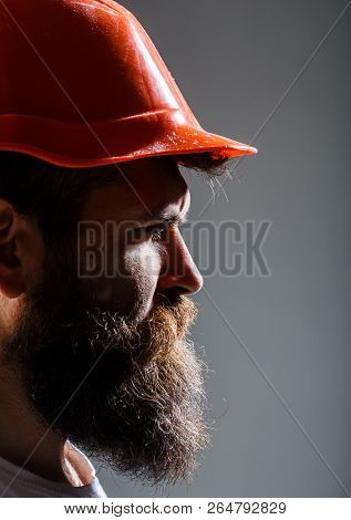 Builder In Helmet, Hammer, Handyman, Builders In Hardhat. Bearded Man Worker With Beard, Building He