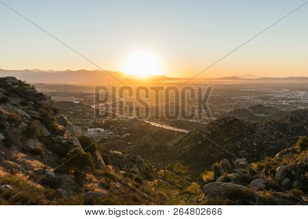 Los Angeles sunrise view of Porter Ranch and the 118 freeway in the San Fernando Valley.  The San Gabriel Mountains, Burbank and North Hollywood, California are in the background.