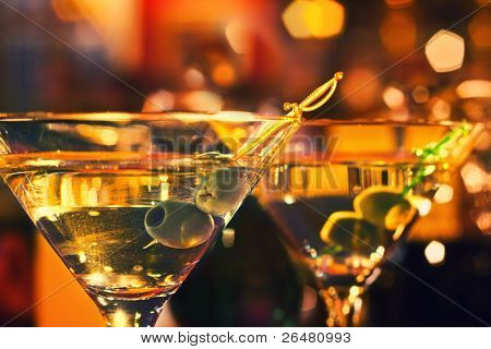 Olive and glass Martini with candle - very small focus