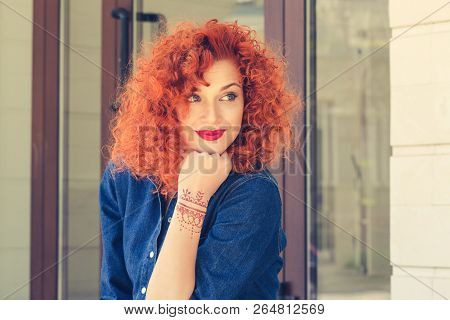 Pensive About New Job New Life. Beautiful Red Head Curly Woman Person Girl Looking To Side Thinking