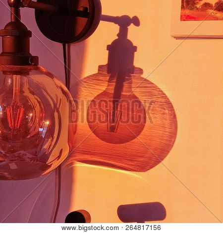 Photo Of  Shadows Of The Bulb Lamp On The Wall.