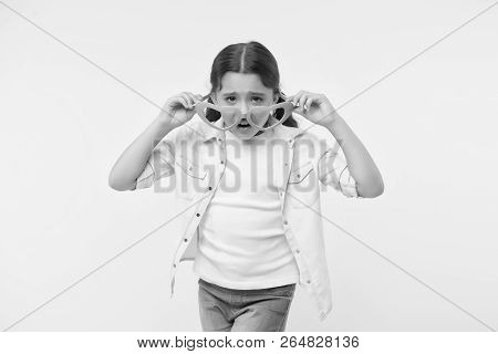 Nobody Likes Me. Kid Girl Unhappy Face Takes Off Heart Shaped Eyeglasses. Girl Feels Lonely And Unha