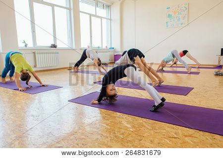 Yoga Lesson For Kids With Teacher In A Room