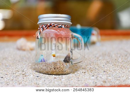 Bottle Of Water And Sand On The Sand Beach