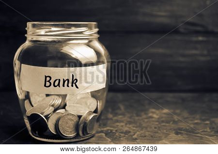 Glass Jar With Coins And The Inscription