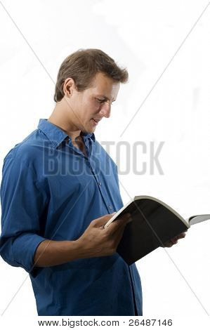 Young handsome caucasian man reading a magazine - isolated
