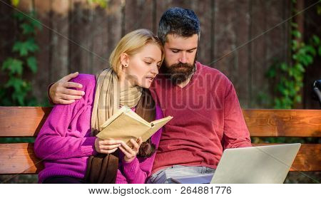 Couple Spend Leisure Reading. Couple With Book And Laptop Search Information. Information Source Con