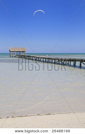 View of tropical cuban beach with wooden walkway, cayo coco.