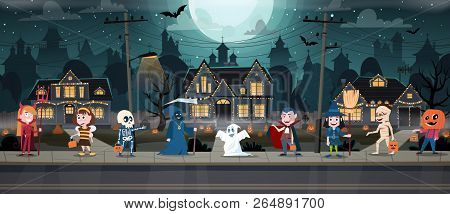 Children In Monster Costumes On A City Street. Trick-or-treating Halloween Ritual. Happy Halloween B