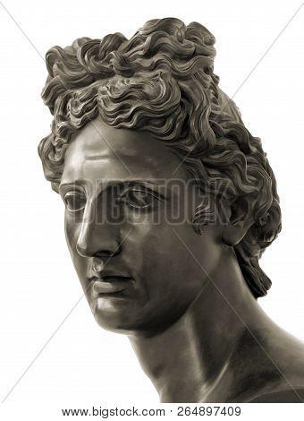 Bronze Statue Of Apollo In Sepia Tone Against White Background. Apollo In Classical Greek And Roman