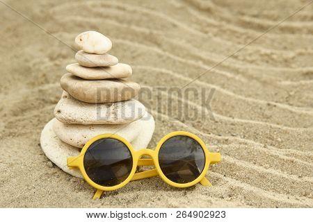 A Seashells And Sunglass On Sand Background