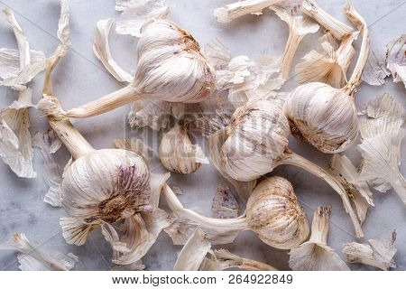 Fresh Raw Organic Garlic Flat Lay On A White Marble Table Top.