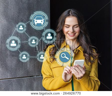 car sharing, modern technology and people concept - smiling teenage girl with smartphone on city street
