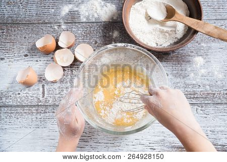 Top View Woman's Hands Cutting Cheese On Wooden Cutting Board On Wooden Table With Grapes And Dried