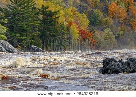 Scenic Flowing River Rapids With Colorful Autumn Trees At Jay Cooke State Park