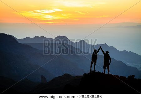 Teamwork Couple Helping Hand Trust Help, Silhouette Success In Mountains. Team Of Climbers Man And W