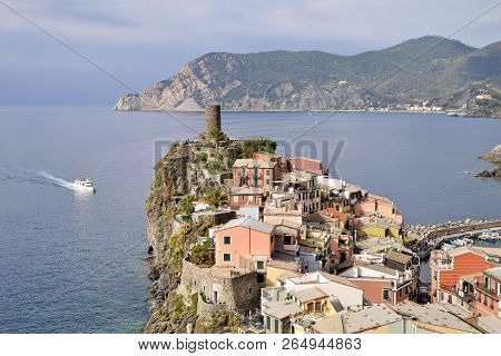 The Arrival Of The Ferry In The Port Of Vernazza In The Cinque Terre In Liguria - Italy