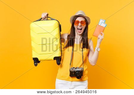 Traveler Tourist Woman In Summer Casual Clothes, Hat With Suitcase, Passport, Ticket Isolated On Yel