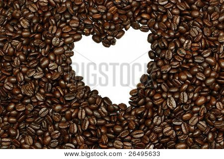 Fresh coffee beans with a white heart at the center.