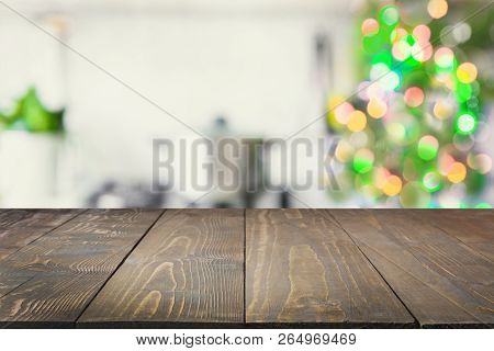 Christmas Table Background With Christmas Tree In Kitchen Out Of Focus. Background For Display Or Mo