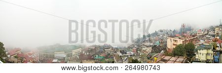 Panorama Of Darjeeling City In East Bengal, India, And The Surrounding Mountains Covered With Thick